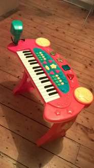 Kids piano with mic and stool. Age 3-5 years.  £5 Tesco in store Didsbury.
