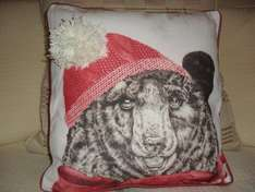 Wilko,s bear cushion with pompom on hat..reduced to £1.00 from 6.00 instore