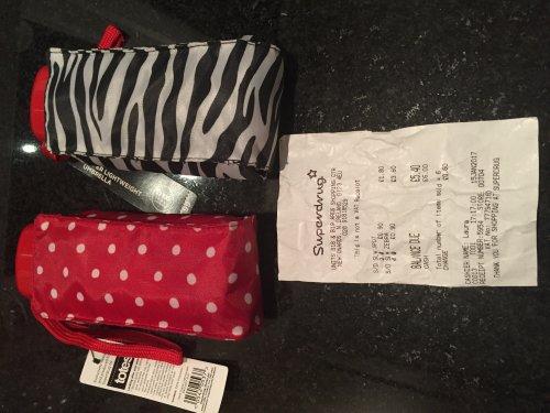 Super lightweight umbrella designed and produced by Totes for Superdrug. Red spotty or Zebra print for 90p @ Superdrug