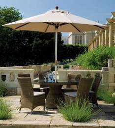 Cadiz Round Table and six chairs, parasol and cushions £1299 @ Holloways