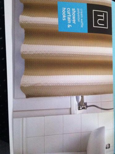 Sainsbury's TU Cream waffle polyester shower curatin and hooks £2.50