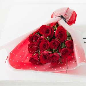 12 red roses with glittered birch £18 delivered at next flowers