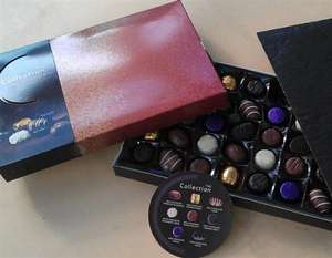 Tesco - The Collection Chocolates.  400g of Milk, Plain and White Chocolates now only 81p a box (dated Dec 2013)