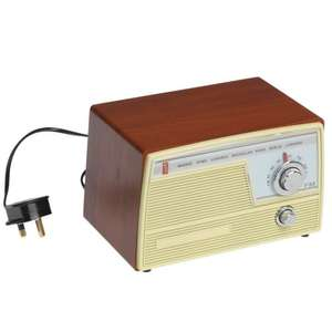 "Vintage Cheap & Nasty kitchen fm radio with real vintage sound (ideal gift for ""Teddy"" boys & girls) £12.90 at DotCom gift shop."