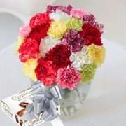 Simply 12 Carnations with Guylian Chocs & Ribbon + Free pop up vase £11.95 delivered @ Flying Flowers + 13% Quidco