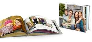 "Free 11"" x 8"" hard custom cover photo book (just pay P&P £3.99) at Snapfish"