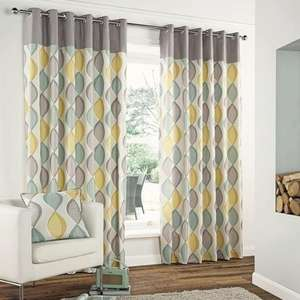 Grey Retro Lined Eyelet Curtains now from £9.99 at Dunelm Mill