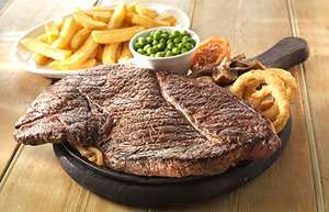 Take the 32oz Steak Challenge OR Trash Can Challenge for £16 (Using Voucher) @ Flaming Grill Pubs