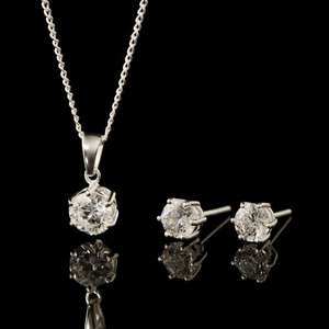 RADIANCE SILVER & SWAROVSKI ZIRCONIA NECKLACE & EARRING SET (£79.99) £17.90 delivered with code @ John Greed