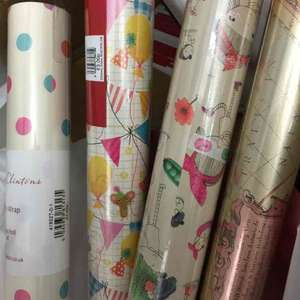 Wrap, tags, gifts etc reduced to clear at Clintons. E.g. wrapping paper 5 for £1