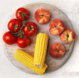 Twin pack sweetcorn or 400g Vine ripened tomatoes or punnet flat peaches 79p each @ Co-op
