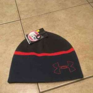 Under Armour knitted beanie hat, £4.99 reduced from £17.99 in store @ American Golf, Aintree.