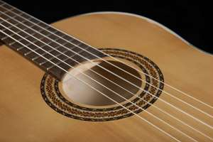 Solid wood classical guitar £85.99 (€95) + €10 shipping @ Thomann.de