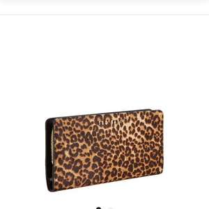 Ted Baker leopard print purse £34.99 / £38.94 delivered at Bargain crazy