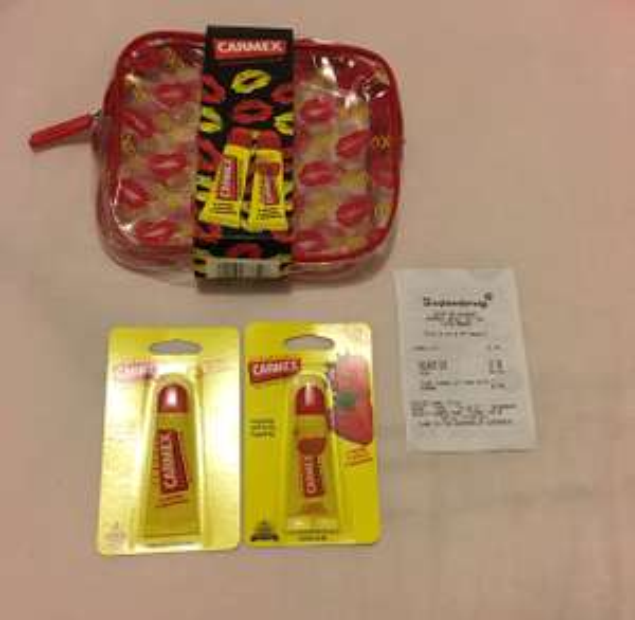 £1.99 for 2 Full Size Carmex Lip Balm + Makeup Bag (Superdrug)