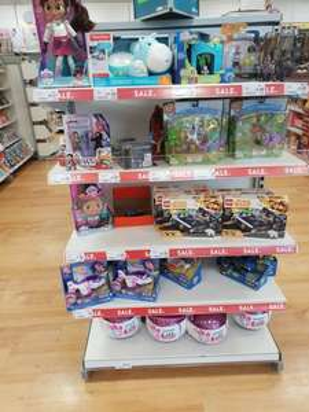 A selection of toys discounted at ASDA Stratford Inc nella talk and sing doll