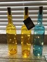 Light Up Wine Bottle only £1 or 3 for £2   incl Bottle (choice of 4 colours) with Battery operated Cork with string of LED Lights@ Poundland