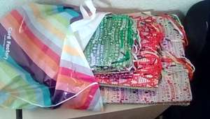 Christmas gift bags, £1 each 4 sizes on offer, multibuy 25p each - 4 for £1 in-store Card Factory Rhyl