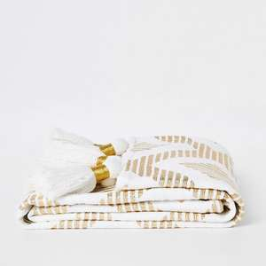 Cream and gold print throw with tassels £20 at River Island