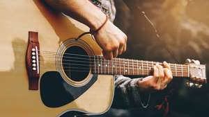 Play YOUR Favorite Songs: The Guitar Super-Course FREE with code