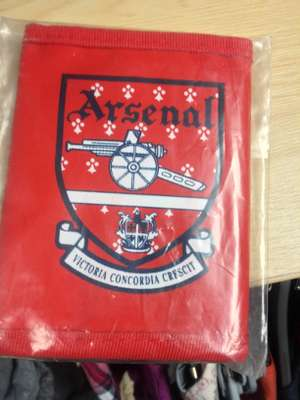 Arsenal wallets - 50p @ Barnardo's (Blackburn bar)