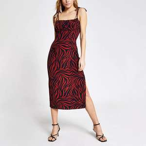 Printed ruched bodice midi slip dress in 2 colours (was £38) Now £15.00 @ River Island (+ £3.95 delivery / Free on £65 spend)